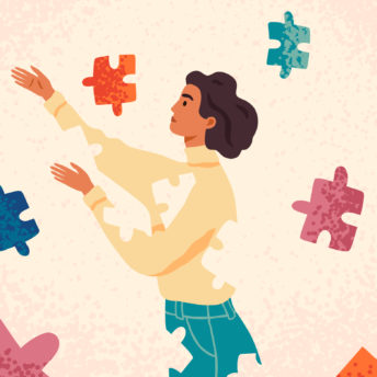 woman putting puzzle pieces together