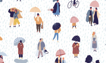 people under umbrellas in the rain