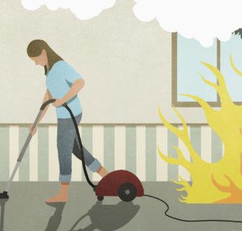 Flames and smoke behind oblivious woman vacuuming carpet